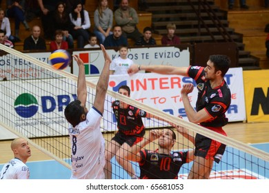 KAPOSVAR, HUNGARY - NOVEMBER 19: Jozsef Nagy (R) strikes the ball at a Middle European League volleyball game Kaposvar (HUN) vs Salonit Anhovo (SLO), November 19, 2010 in Kaposvar, Hungary