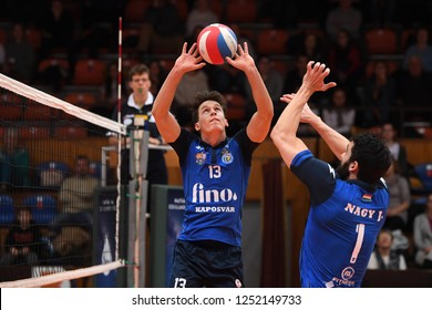 KAPOSVAR, HUNGARY – NOVEMBER 29, 2018: Cameron Keen (with ball) in action at a Hungarian National Cup volleyball game between Kaposvar (blue) and MAV Elore (white) in Sportcsarnok Kaposvar.