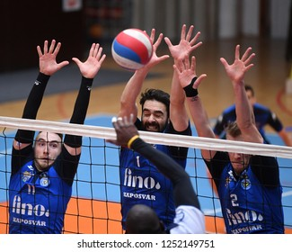 KAPOSVAR, HUNGARY – NOVEMBER 29, 2018: Jozsef Nagy (c) block the ball at a Hungarian National Cup volleyball game between Kaposvar (blue) and MAV Elore (white) in Sportcsarnok Kaposvar.