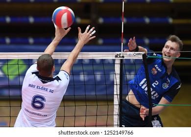 KAPOSVAR, HUNGARY – NOVEMBER 29, 2018: Bence Bozoki (blue 2) in action at a Hungarian National Cup volleyball game between Kaposvar (blue) and MAV Elore (white) in Sportcsarnok Kaposvar.