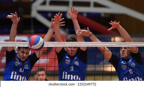 KAPOSVAR, HUNGARY – NOVEMBER 29, 2018: Adrian Kulcsar (c) in action at a Hungarian National Cup volleyball game between Kaposvar (blue) and MAV Elore (white) in Sportcsarnok Kaposvar.