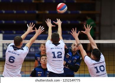 KAPOSVAR, HUNGARY – NOVEMBER 29, 2018: Norbert Kholmann white 12 in action at a Hungarian National Cup volleyball game between Kaposvar (blue) and MAV Elore (white) in Sportcsarnok Kaposvar.