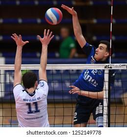 KAPOSVAR, HUNGARY – NOVEMBER 29, 2018: Kristof Horvath (blue 12) in action at a Hungarian National Cup volleyball game between Kaposvar (blue) and MAV Elore (white) in Sportcsarnok Kaposvar.