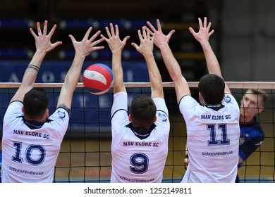 KAPOSVAR, HUNGARY – NOVEMBER 29, 2018: Tamas Kaposi (white 10) in action at a Hungarian National Cup volleyball game between Kaposvar (blue) and MAV Elore (white) in Sportcsarnok Kaposvar.