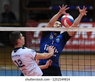 KAPOSVAR, HUNGARY – NOVEMBER 29, 2018: Jozsef Nagy blocked the ball at a Hungarian National Cup volleyball game between Kaposvar (blue) and MAV Elore (white) in Sportcsarnok Kaposvar.