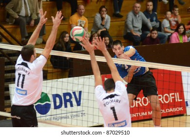 KAPOSVAR, HUNGARY - OCTOBER 16: Karoly Lesznyik (in blue) in action at a Hungarian National Championship volleyball game Kaposvar (blue) vs. MAFC-BME (white), October 16, 2011 in Kaposvar, Hungary.