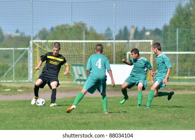KAPOSVAR, HUNGARY - OCTOBER 2: Unidentified players in action at the Hungarian National Championship under 17 game between Kaposvar (green) and Nagykanizsa (black) October 2, 2010 in Kaposvar, Hungary