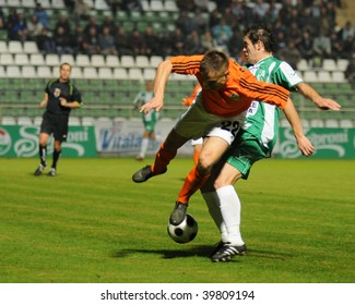KAPOSVAR, HUNGARY - OCTOBER 28: Babic (22) and Gujic (R) in action at a Hungarian National Cup soccer game Kaposvar vs Gyor October 28, 2009 in Kaposvar, Hungary.