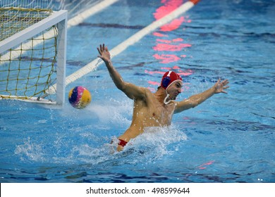 KAPOSVAR, HUNGARY - OCTOBER 5: Attila Decker in action at a Hungarian national championship water-polo game between Kaposvar (white) and Racionet Honved (blue) on October 5, 2016 in Kaposvar, Hungary