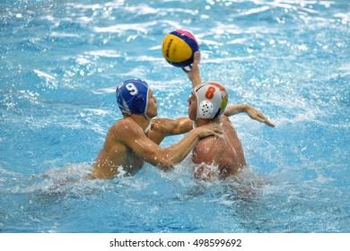 KAPOSVAR, HUNGARY - OCTOBER 5: David Dobos (in white) in action at a Hungarian national championship water-polo game between Kaposvari (white) and Honved (blue) on October 5, 2016 in Kaposvar, Hungary