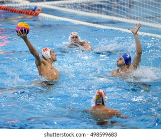 KAPOSVAR, HUNGARY - OCTOBER 5: Ferenc Windisch (white 10) in action at a Hungarian championship water-polo game between Kaposvar (white) and Honved (blue) on October 5, 2016 in Kaposvar, Hungary