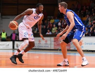 KAPOSVAR, HUNGARY - OCTOBER 6: Malik Cooke (with ball) in action at Hungarian Championship basketball game with Kaposvar (white) vs. Sopron (blue) on October 6, 2016 in Kaposvar, Hungary.