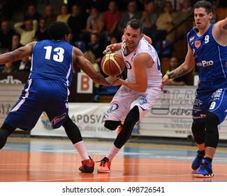 KAPOSVAR, HUNGARY - OCTOBER 6: Marton Fodor (white 8) in action at Hungarian Championship basketball game with Kaposvar (white) vs. Sopron (blue) on October 6, 2016 in Kaposvar, Hungary.