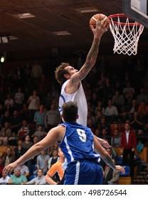 KAPOSVAR, HUNGARY - OCTOBER 6: Roland Hendlein (white 11) in action at Hungarian Championship basketball game with Kaposvar (white) vs. Sopron (blue) on October 6, 2016 in Kaposvar, Hungary.