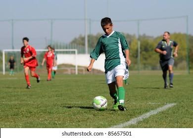 KAPOSVAR, HUNGARY - SEPTEMBER 11: Roland Vajda (green) in action at the Hungarian National Championship under 15 game between Kaposvar (green)  and Lenti (red) September 11, 2011 in Kaposvar, Hungary.