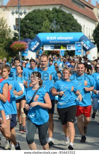 KAPOSVAR, HUNGARY - SEPTEMBER 18: Unidentified runners at the K&H Running Day running race September 18, 2011 in Kaposvar, Hungary.