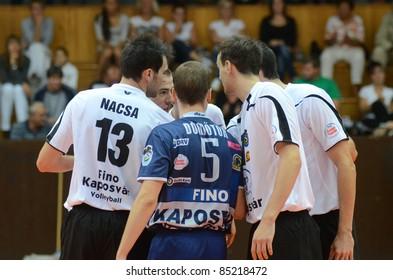 KAPOSVAR, HUNGARY - SEPTEMBER 21: Kaposvar players celebrate at a Hungarian National Championship volleyball game Kaposvar (white) vs. Kecskemet (black), September 21, 2011 in Kaposvar, Hungary.