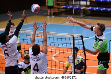 KAPOSVAR, HUNGARY - SEPTEMBER 30: Bence Bozoki (in right) in action at a Hungarian National Championship volleyball game Kaposvar (green) vs. PEAC (white), September 30, 2016 in Kaposvar, Hungary.
