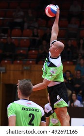 KAPOSVAR, HUNGARY - SEPTEMBER 30: Zoltan David (with ball) in action at a Hungarian National Championship volleyball game Kaposvar (green) vs. PEAC (white), September 30, 2016 in Kaposvar, Hungary.