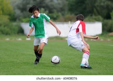KAPOSVAR, HUNGARY - SEPTEMBER 4: Unidentified players in action at the Hungarian National Championship under 15 game between Kaposvari Rakoczi and Barcs September 4, 2010 in Kaposvar, Hungary.