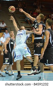 KAPOSVAR, HUNGARY - SEPTEMBER 8: Josh Wilson (white 20) in action at a friendly basketball game between Kaposvar (white) and Pecsi VSK (black) September 8, 2011 in Kaposvar, Hungary.