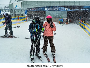 KAPRUN, AUSTRIA, January 04 2016: Skiers are getting out from ski lift and make preparations for skiing while the snow falls at glacier Kitzsteihorn at Kaprun, Austria