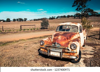 Kapunda, South Australia - June 17, 2017: Old rusty Holden FJ Ute near local farm entrance viewed from highway