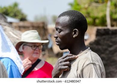 KARA REG., TOGO - JAN 14, 2017: Unidentified Konkomba man looks ahead in the village.Konkombas are an ethnic group of Togo