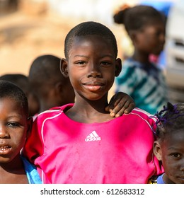 KARA REG., TOGO - JAN 14, 2017: Unidentified Konkomba little boy in pink shirt smiles in the village. Konkombas are ethnic group of Togo