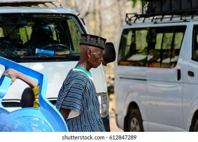 KARA REG., TOGO - JAN 14, 2017: Unidentified Konkomba old man walks in the village. Konkombas are ethnic group of Togo