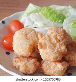 Karaage, Japanese Fried Chicken with tomato and lettuce salad.