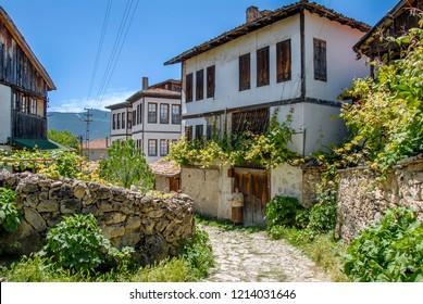 Karabuk, Turkey, 22 May 2013: Historic Mansions with Woman, Yoruk Village of Safranbolu