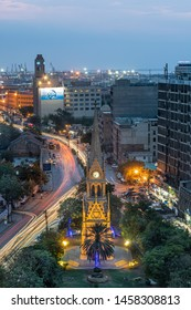 Karachi, Karachi/Pakistan - Jul 22, 2019 : Merewether clock tower karachi at evening with traffic trail lights with blue sky and clouds
