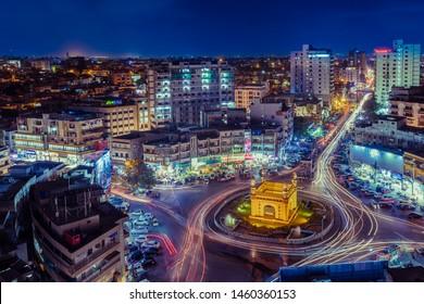 Karachi, Karachi/Pakistan - July 24, 2015: Aerial View Charminar roundabout in night and traffic trail light around the charminar