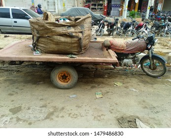 Karachi Pakistan - 15 Aug 2019: A motorcycle carriage which is used to carry trash and garbage. Karachi is the among the worst city in terms of disposable of waste material