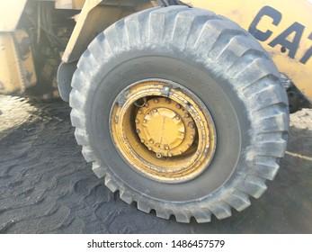 Karachi , Pakistan - 23 Aug 2019:  A heavy duty tyre ( wheel / ture) of a loader from Caterpillar in a coal yard