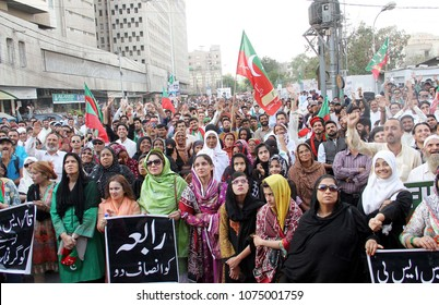 KARACHI, PAKISTAN - APR 22: Activists of Tehreek-e-Insaf (PTI) are holding protest demonstration against rape and murder of minor Rabia, on April 22, 2018 in Karachi.