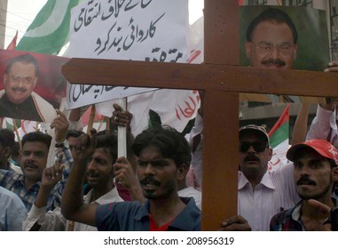 KARACHI, PAKISTAN - AUG 04: Activists of MQM are protesting against raid on their MNA, Farooq Sattar residency located in PIB Colony, during a demonstration club on  August 04, 2014 in Karachi.