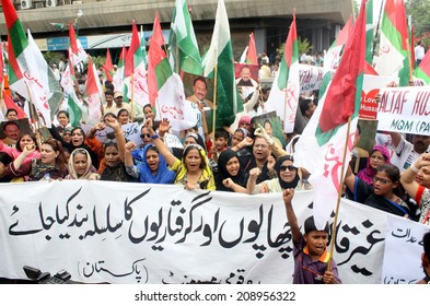 KARACHI, PAKISTAN - AUG 04: Activists of MQM are protesting against raid on their MNA, Farooq Sattar residency located in PIB Colony, during a demonstration on August 04, 2014 in Karachi.