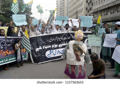 KARACHI, PAKISTAN - AUG 15: Kashmiri people are holding protest demonstration as they are marking Independence Day of India as black day, outside Karachi press club on August 15, 2018 in Karachi.