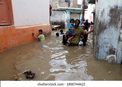 KARACHI, PAKISTAN - AUG 22: Residents are facing difficulties due to flooded area caused by heavy downpour of monsoon season due to poor sewerage system, on August 22, 2020 in Karachi.