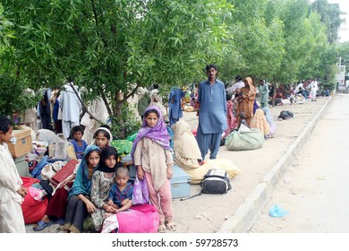 KARACHI, PAKISTAN - AUG 23: Flood affected families take shelter along a footpath while waiting for relief and food at Cantt railway station on August 23,  2010 in Karachi, Pakistan. (Rizwan Ali/PPI Images)