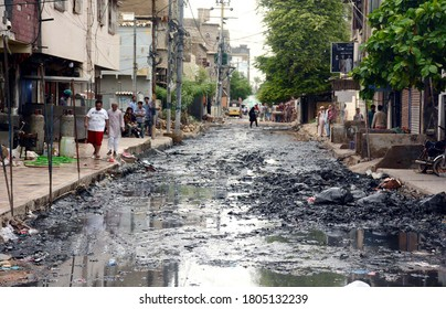 KARACHI, PAKISTAN - AUG 29: Inundated road by garbage and sewerage water after overflow of rain drains caused by heavy downpour of monsoon due to poor sewerage system, on August 29, 2020 in Karachi.