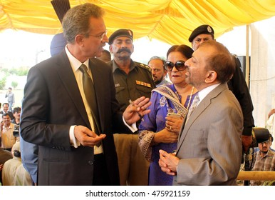 KARACHI, PAKISTAN - AUG 30: Elected mayor Karachi, Waseem Akhtar meets MQM leader Farooq Sattar after taking oath during ceremony held at Bagh-e-Quaid-e-Azam on August 30, 2016 in Karachi.