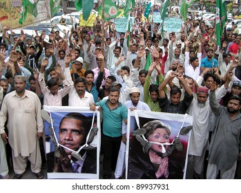 KARACHI, PAKISTAN - DEC 01: Supporters of Sunni Tehreek (ST) chant slogans against NATO attack in the Country, during a protest demonstration at Karachi press club on December 01, 2011.