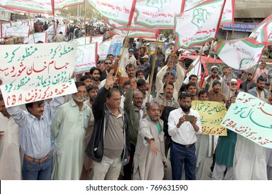 KARACHI, PAKISTAN - DEC 05: KMC employees are holding protest demonstration against high handedness of officers, outside Karachi press club on December 05, 2017.