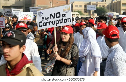 KARACHI, PAKISTAN - DEC 06: Members of Civil Society are holding walk against  corruption on call of National Accountability Bureau, passing through road on December 06, 2016 in Karachi.