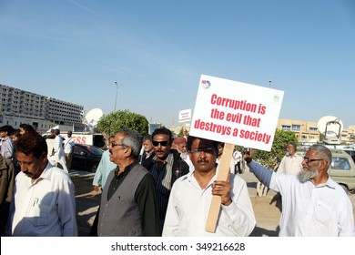 KARACHI, PAKISTAN - DEC 09: Citizens and NAB employees are holding awareness walk on the occasion of International Anti Corruption Day, on December 09, 2015 in Karachi.