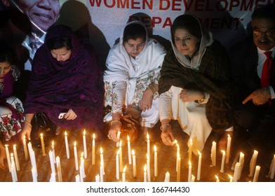 KARACHI, PAKISTAN - DEC 10: Sindh Assembly members enlightening candles in memory of Nelson Mandela who died on Thursday at age 95 during a demonstration on December 10, 2013 in Karachi.