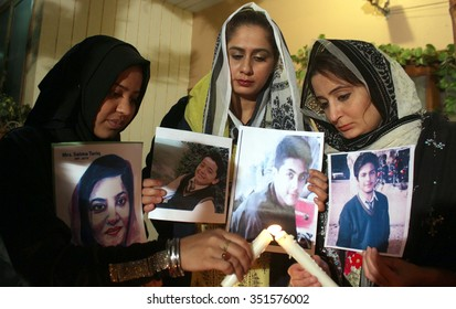 KARACHI, PAKISTAN - DEC 15: Civil society holding a candle light vigil in memory of  students who assassinated during attack on APS Peshawar on December-16-2014. on December 15, 2015 in Karachi.